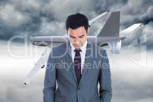 Composite image of unsmiling businessman standing