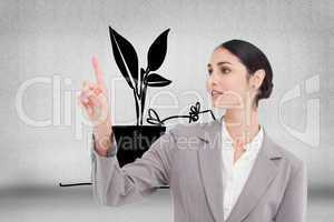 Composite image of young saleswoman operating touchscreen