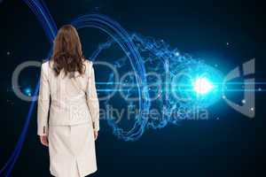 Composite image of classy businesswoman walking away from camera