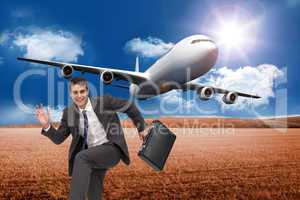 Composite image of happy businessman in a hury