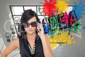 Composite image of serious elegant brunette wearing sunglasses o