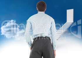 Composite image of businessman standing with hand in pocket