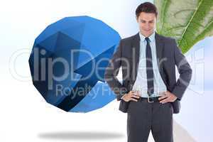 Composite image of smiling businessman with hands on hips