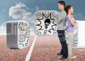 Composite image of young couple standing back to back