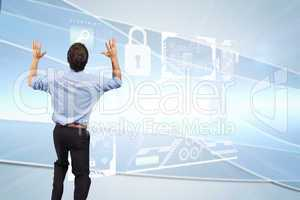 Composite image of businessman posing with arms up