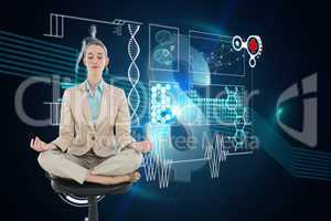 Composite image of peaceful chic businesswoman sitting in lotus