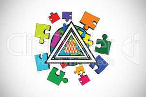 Composite image of jigsaw with earth pyramid design doodles