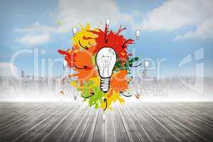 Composite image of light bulb on paint splashes