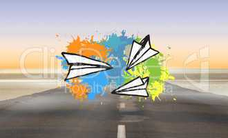 Composite image of paper airplanes on paint splashes