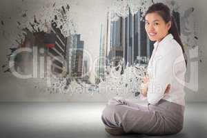 Composite image of businesswoman sitting cross legged with arms