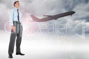 Composite image of serious businessman standing with hand in poc