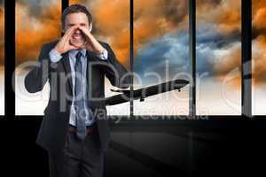 Composite image of shouting businessman