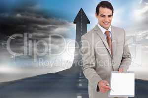 Composite image of smiling salesman asking for signature