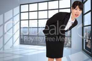 Composite image of surprised businesswoman bending