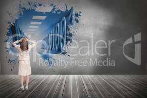 Composite image of businesswoman with hands on head standing bac