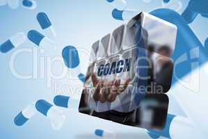 Composite image of businessman holding coach text on abstract sc