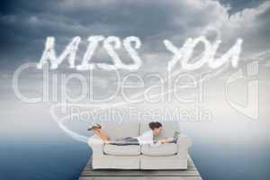 Miss you against cloudy sky over ocean