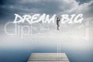 Dream big against cloudy sky over ocean