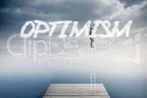 Optimism against cloudy sky over ocean