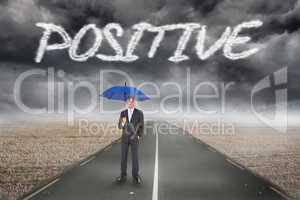 Positive against misty brown landscape with street