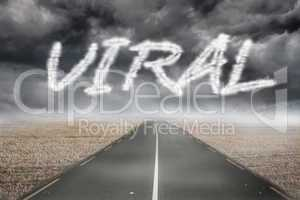 Viral against misty brown landscape with street