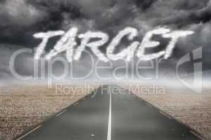 Target against misty brown landscape with street