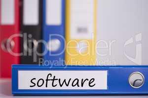 Software on blue business binder