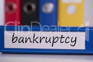 Bankruptcy on blue business binder