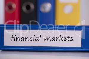Financial markets on blue business binder