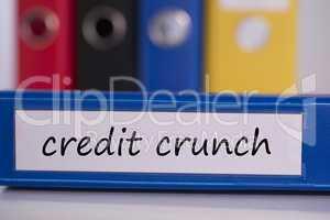 Credit crunch on blue business binder