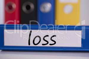 Loss on blue business binder