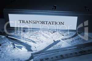 Transportation on blue business binder