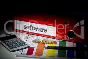 Software on red business binder