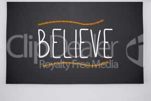 Believe written on big blackboard