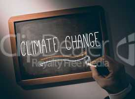 Hand writing Climate change on chalkboard