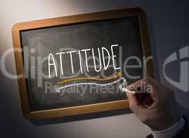 Hand writing Attitude on chalkboard
