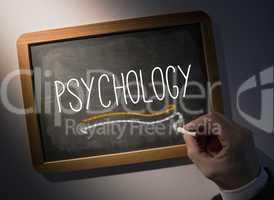 Hand writing Psychology on chalkboard