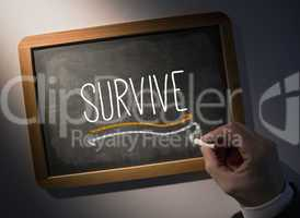 Hand writing Survive on chalkboard