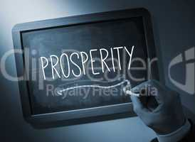Hand writing Prosperity on chalkboard