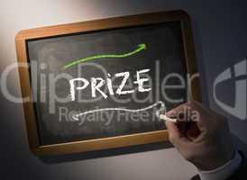 Hand writing Prize on chalkboard