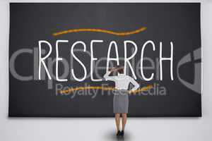 Businesswoman reading the word research