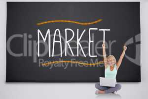 Cheering blonde with laptop against the word market