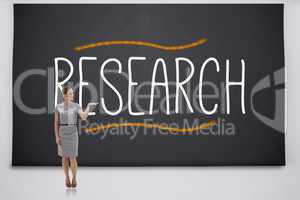 Businesswoman presenting the word research