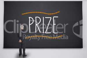 Businessman reading the word prize