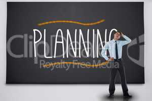 Businessman thinking against the word planning