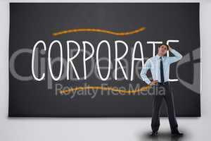 Businessman thinking against the word corporate