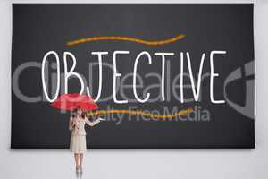 Businesswoman holding umbrella against the word objective