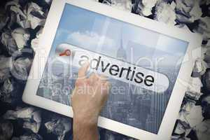 Hand touching advertise on search bar on tablet screen