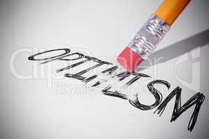 Pencil erasing the word Optimism