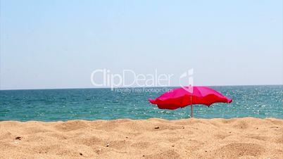 Beach umbrella on ocean coast, Algarve